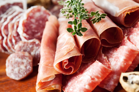 Cold cuts: charcuterie assortment on wooden board