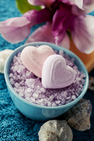 blue flowers: Spa setting with bath salt  and bath accessories on blue towel Stock Photo