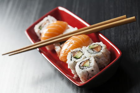 Sushi assortment on plate with chopsticks Stock Photo