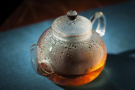 misted: Misted glass tea pot in sunbeams
