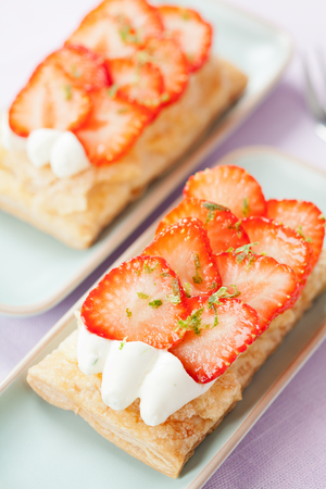 puff pastry: Puff pastry tarts with cream and strawberries