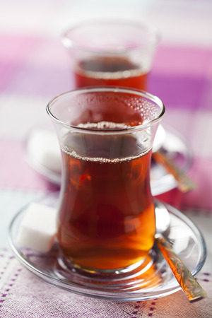 hospitality: Turkish black tea in traditional tea glass Stock Photo