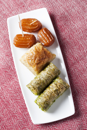 yufka: Variety of oriental sweets with cup of coffee