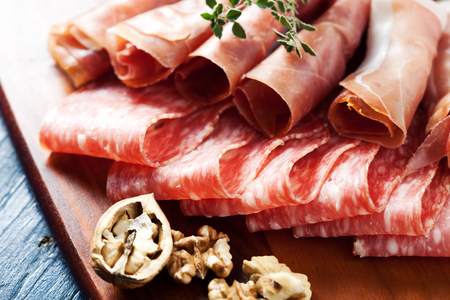 antipasto platter: Cold cuts: charcuterie assortment on wooden board