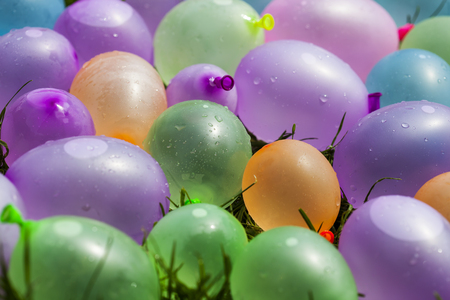 sun  soaked: Summer fun concept: colorful water balloons, background