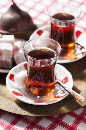 Turkish tea in traditional glass cups and saucers Stock Photo