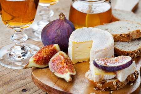 cheeseboard: Cheese plate. Variety of cheese sorts with grapes and figs