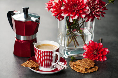 percolator: Cup of coffee with  coffee maker and flowers