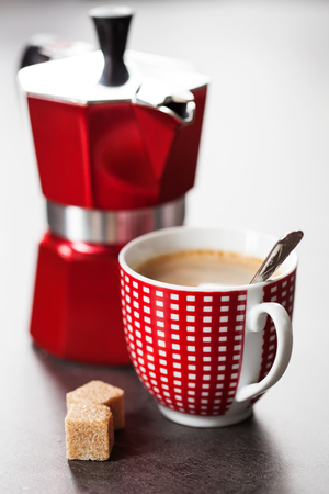 percolator: Red and white cup of coffee and percolator Stock Photo