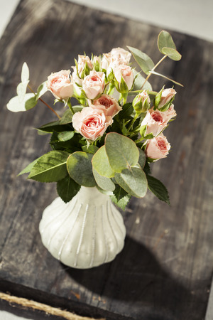 Bouquet of beautiful pink spray roses in vase