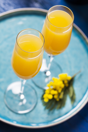 Two glasses with mimosa cocktail (cave plus orange juice) Stock Photo