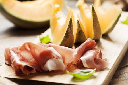 Slices of cantaloupe melon and prosciutto ham, shallow DOF