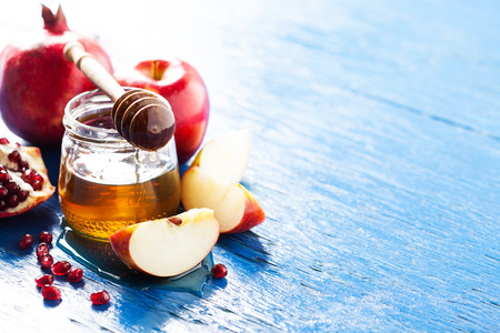 Rosh hashanah (jewish holiday) concept: honey, apple and pomegranate, with space for text Stock Photo