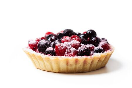 patisserie: Sweet tartlet with berries on white background