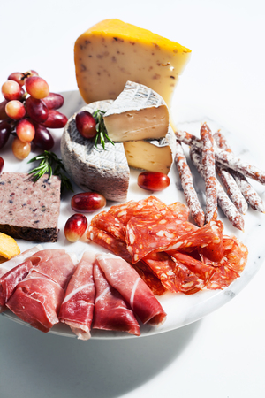 Food tray with charcuterie assortment, cheese  and grapes Stock Photo