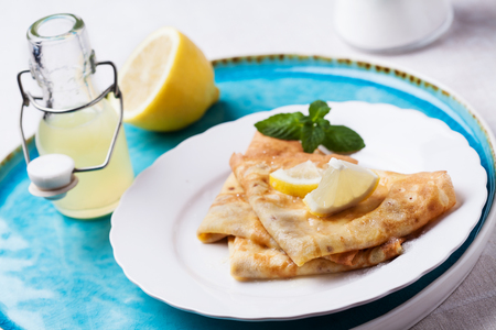 English-style pancakes with lemon and sugar, traditional for Shrove Tuesday Stock Photo - 90616305