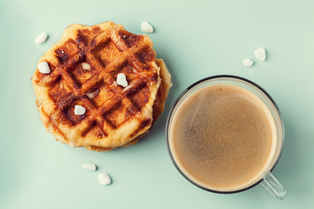 Homemade Belgian Liege or sugar waffles with cup of coffee