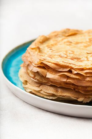 Stack of pancakes on plate traditional for pancake week