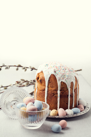 Traditional Russian Orthodox Easter bread - kulich with willow twigs and chocolate eggs
