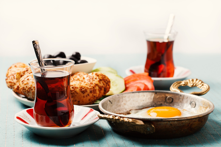 Traditional Turkish breakfast with fried eggs and tea. Travel concept Stock Photo