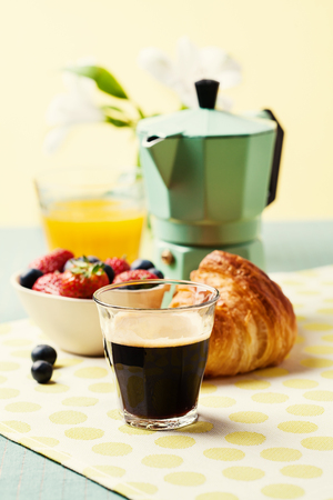 Breakfast setting with coffee, croissant and orange juice