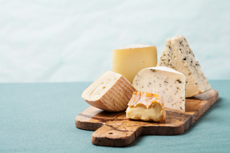 Cheese board: variety of cheeses on marble serving board