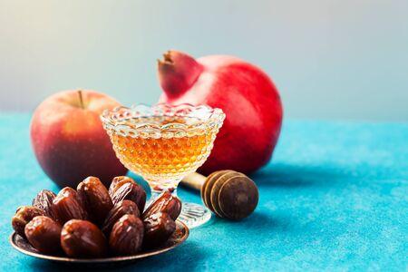 Rosh hashanah (jewish holiday) concept: honey, apple and pomegranate