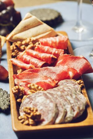 Two glasses of red wine with charcuterie assortment, beaujolais concept Stock Photo