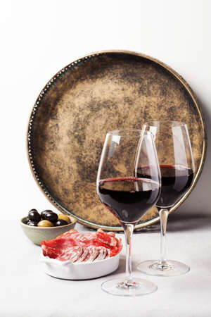 Two glasses of red wine with charcuterie assortment, beaujolais  nouveau concept
