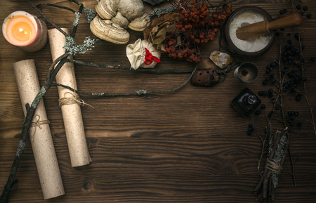 Ancient magic scroll on wooden desk table. Witchcraft. Witch doctor desk table. Magic potion. Alternative medicine concept.