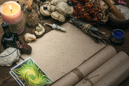 Tarot cards on fortune teller desk table. Witch doctor. Witchcraft. Magic herbal collection. Stock Photo