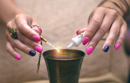 Witch prepares a magic potion. Stock Photo