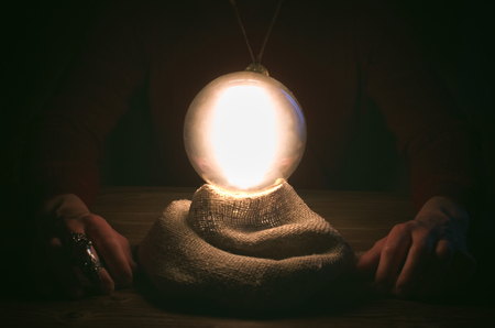 Crystal ball and fortune teller hands. Divination concept. The spiritual seance. Future reading. 스톡 콘텐츠