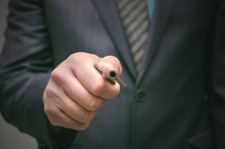 Key to success concept. Businessman holding in hands an old rusty key and opens the door, front view. Explanation of information decryption key. Access to forbidden materials.