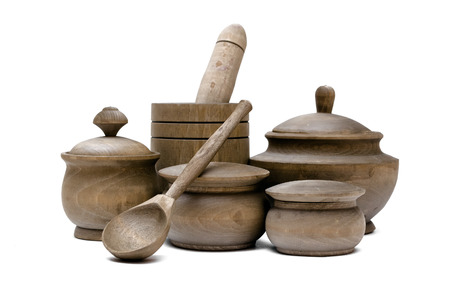 Wooden kitchen pots and mortar with pestel isolated on white background. Kitchenware. Kitchen utencils.