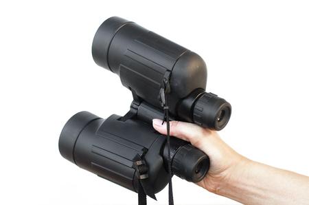 Binoculars isolated. Binoculars in hand.