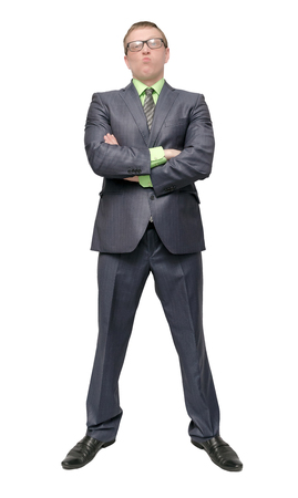 Angry arrogant businessman is standing with crossed arms isolated on white background. Dissatisfied and angry boss. Imagens