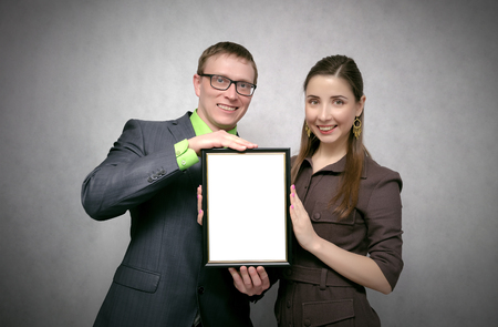 Awarding a diploma certificate to a best employee or student mock up. Winner award ceremony concept. One person handing a blank diploma with copy space to another person. Best worker or student.