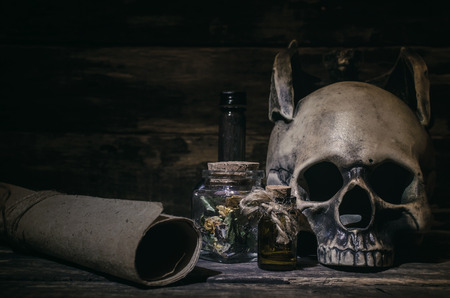 Magic potion and human skull on magic table background. Witchcraft concept. Stock Photo