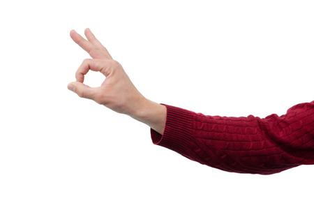 La mano del hombre está mostrando un signo bien aislado sobre fondo blanco. Ningún gesto de problema. Foto de archivo