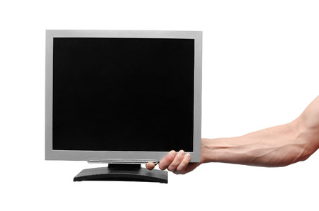TV computer monitor with blank screen in the male hand isolated on white background.
