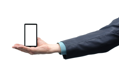 Mobile phone with blank screen in the businessman hand isolated on the white background. Stock Photo