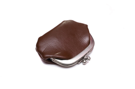 Brown old fashioned leather wallet isolated on the white background.