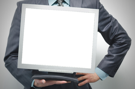 TV computer monitor with blank screen in the businessman hand isolated on white background.
