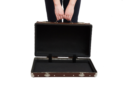 Retro suitcase and female hands isolated on the white background.