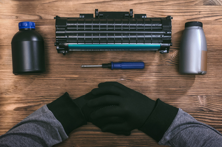 Laser cartridge toner refill concept. Office equipment maintenance concept.