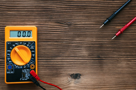 Multimeter on the electrician work table background with copy space. Electric work. Stock Photo