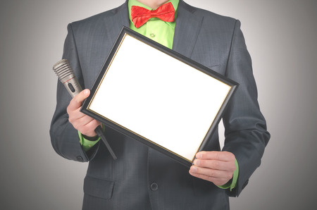 Blank diploma or certificate mockup in a presenter hands. Award ceremony. Product presentation. Special offer.