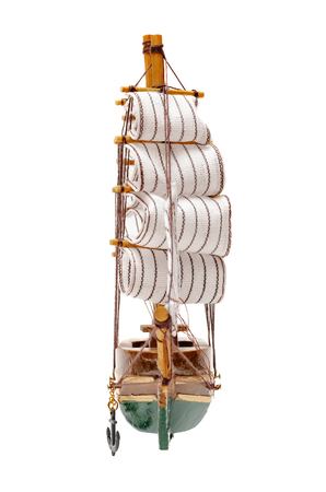 Sail ship toy isolated on the white background.