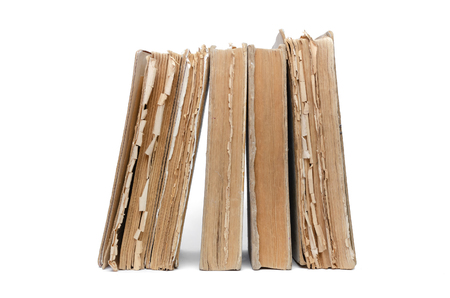 Stack of aged books isolated on a white background. Imagens